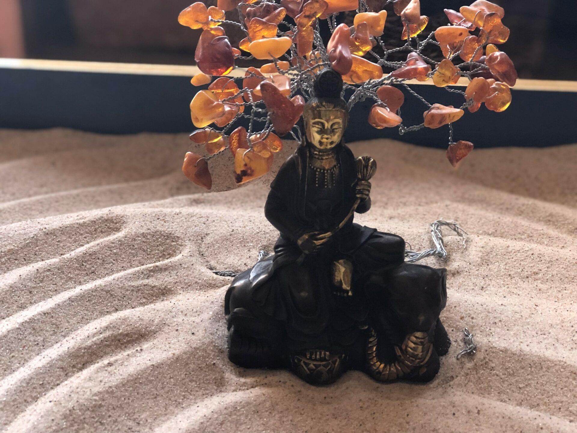 Buddha under tree closeup